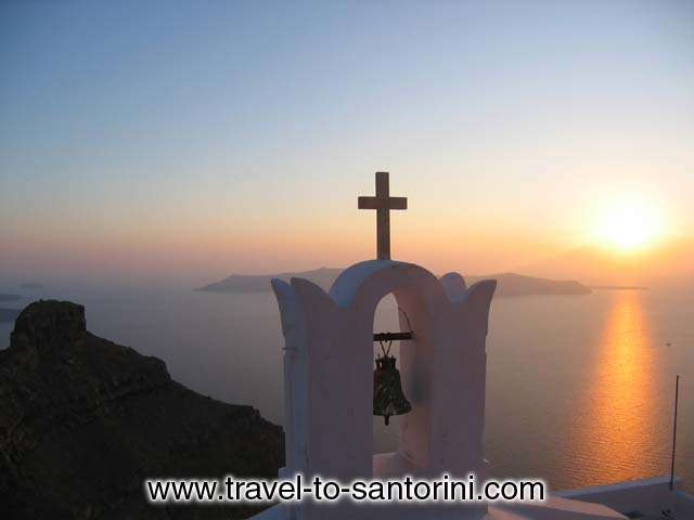 AGIO PNEYMA - A sunset from Agio Pneyma church at Imerovigli. A great view of the Caldera in front of Skaros with sunset behind Thirassia and Oia.