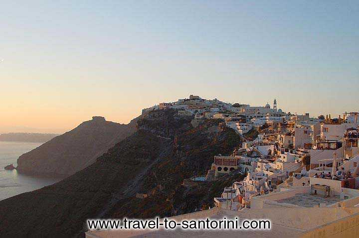 Fira and Skaros in the afternoon sunset light.<BR>