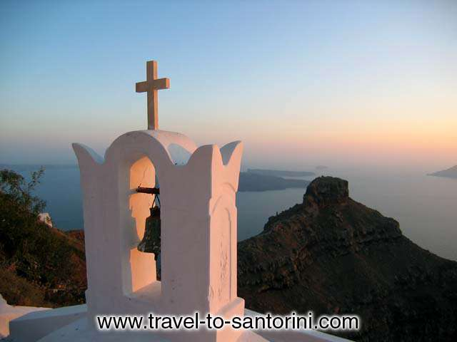 View of Skaros from Agio Pneyma church in Imerovigli during the sunset.<br>  In the background are visible Palea and Nea Kameni (the volcano) and Aspronissi. SANTORINI PHOTO GALLERY - SKAROS AT SUNSET by Ioannis Matrozos