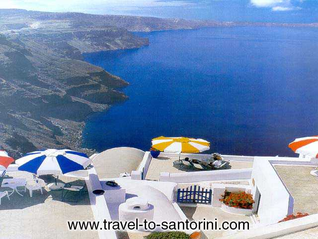 White Cycladic houses - A poster of the island of Santorini, with crisp white Cycladic houses on volcanic cliffs rising from the sea.