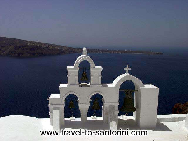 The view of Roka on Thirassia from behind a church in Oia.<br> Genuine sample of the cycladic architecture we find on churches. SANTORINI PHOTO GALLERY - OIA CHURCH BELLS by Ioannis Matrozos