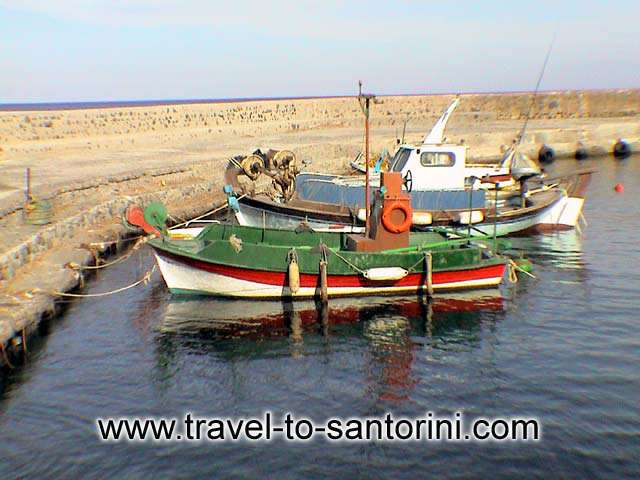 Boats in Vourvoulos harbor - Fishing boats in Vourvoulos beach. It is one of the place to find fresh fish in Santorini.