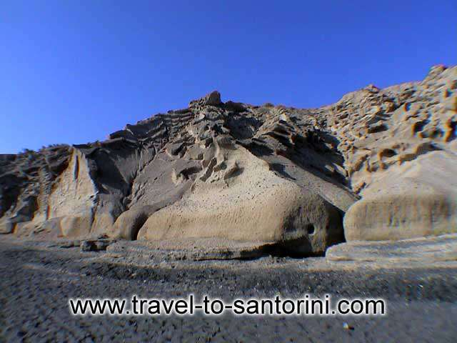 PUMICE STONE FORMATIONS - View of the cliff behind Vlihada beach.