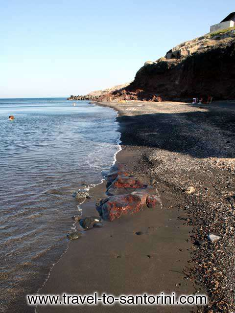AFTERNOON - The beach of Pori in Santorini in the afternoon when the rocks above the beach offer their shadow