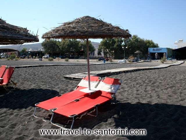 UMBRELLA - The biggest part of Perivolos beach is organised with umbrellas