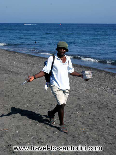 MAN - Man selling music cds in Perivolos beach