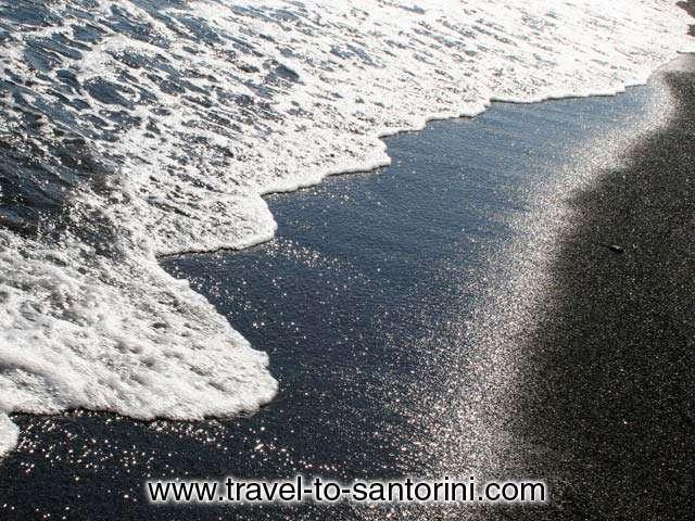 FLISVOS - Wave on the sand of Perivolos beach