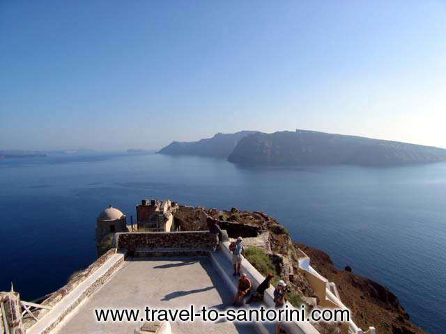 View of Thirassia from within the castle of Oia, one of the must places in Santorini. <br>Also visible Aspronissi and a small part of Palaia Kammeni. SANTORINI PHOTO GALLERY - THIRASSIA VIEW FROM IA
