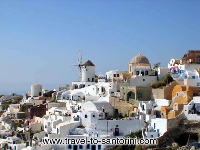 View of the northern part of Oia from the castle. This is the area just above Ammoudi. <br> The picture highlights the windmill that is the first recognisable building from the passing through ships. SANTORINI PHOTO GALLERY - OIA SPOT by Ioannis Matrozos