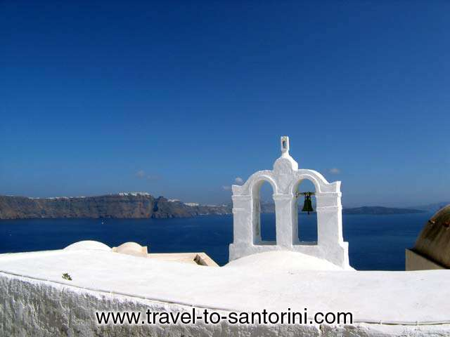 Church bell in Oia, Imerovigli and Kameni island (volcano) in the background. SANTORINI PHOTO GALLERY - OIA CHURCH BELL