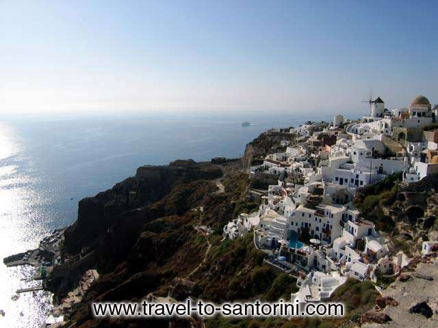 View of the last part of Oia at the northern edge of Santorini. It is the area after Oia castle. <BR>Here is located the stairway to Ammoudi. Also visible the famous windmill of Oia. SANTORINI PHOTO GALLERY - OIA WINDMILL