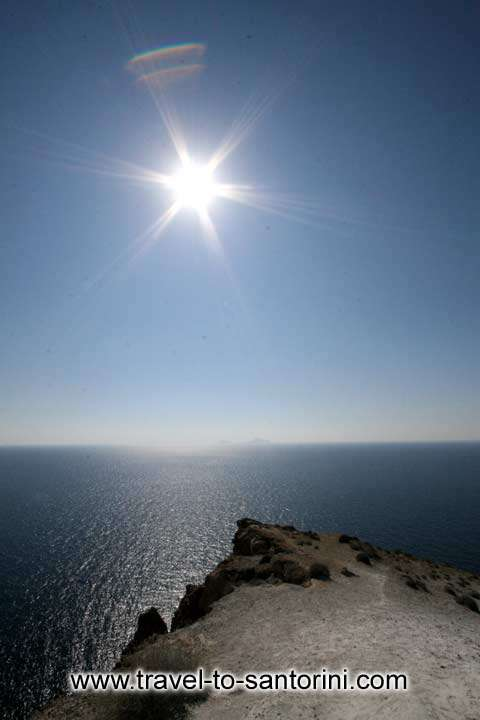 SUN & ROCK - View of Christiana islands in the sea by Ioannis Matrozos