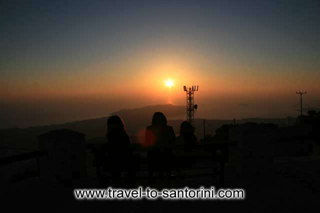 Sunset - Three girls wathcing the sunset from Profitis Ilias by Ioannis Matrozos