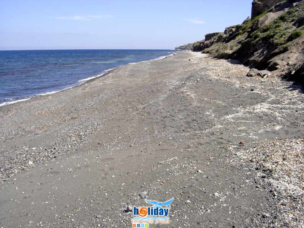 Baxedes beach sand - View of the sand and pebble beach of Baxedes at the east part of Santorini, in the area of Oia