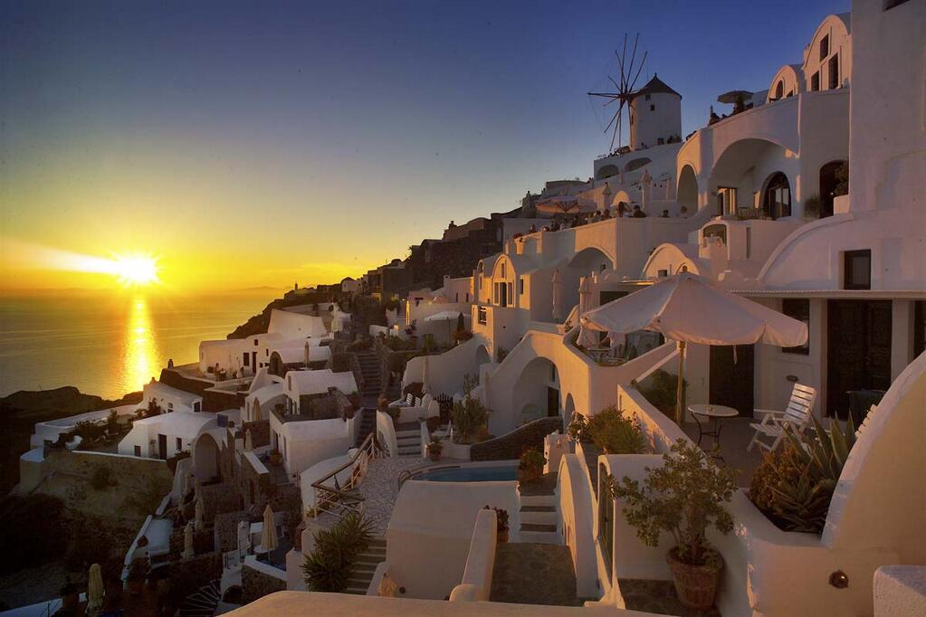 Oia North Windmill - In the photo visible Golden Sunset Villas