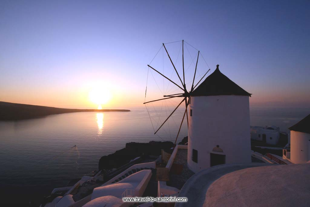 Golden Sunset Villas windmill - View of the famous windmill at the northern edge of Oia at sunset by Ioannis Matrozos