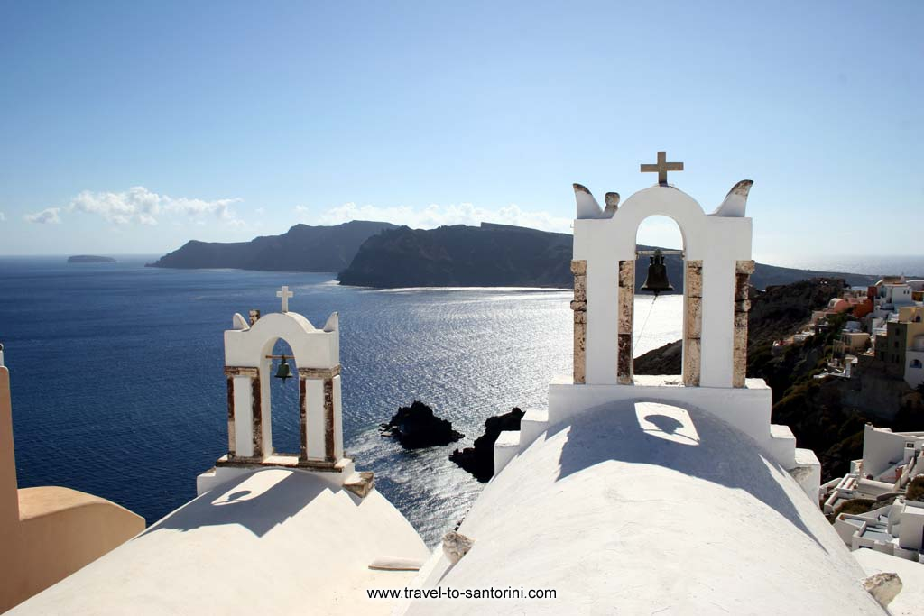 Oia church - View of Oia caldera from a church in Oia. Thirassia in the background. by Ioannis Matrozos