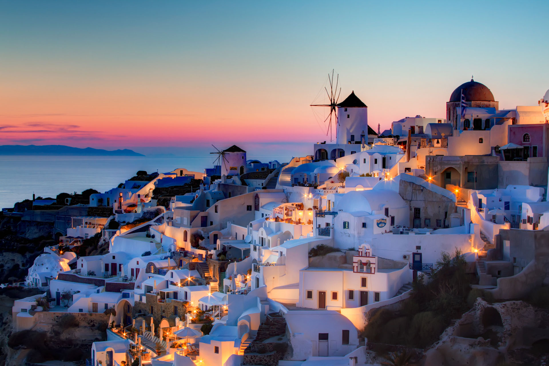 Sunset in Oia, Santorini - The sun setting over the picturesque town of Oia, Greece by Pedro Szekely