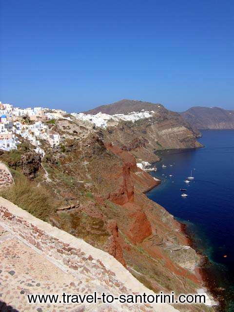 CALDERA VIEW - View of the village, Perivolas and the caldera from the castle in Oia