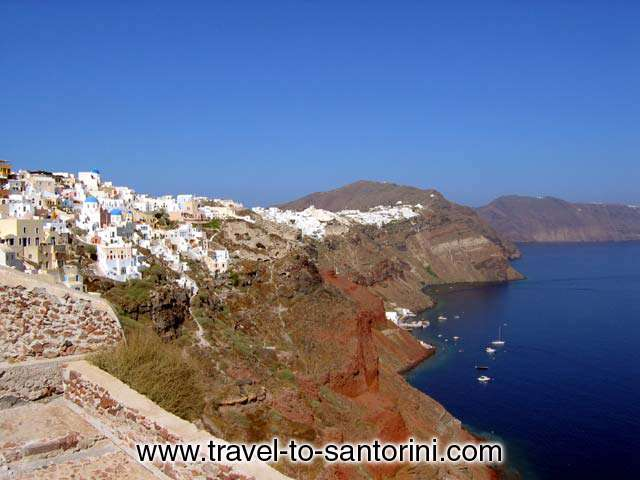 OIA CALDERA - View of Oia from within the castle. Visible Armeni and several fishing boats and yachts anchored, <br>Perivolas area and the caldera on the way to Imerovigli