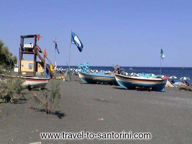 KAMARI BLUE FLAG - Boats and the blue flag at Kamari. The beach is being awarded the blue flag of clean seas for the last 10 years.