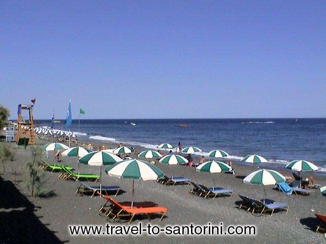 KAMARI BEACH - Kamari is a well organised beach. There are plenty of restaurants, cafes, umbrellas, watersports etc.