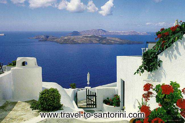 VOLCANO AND THIRASSIA - View of the volcano and Thirassia from the small yard of a traditional house in Imerovigli. <br>This exact location (next to Anastasis church) is one of the best spots in Santorini for the view!