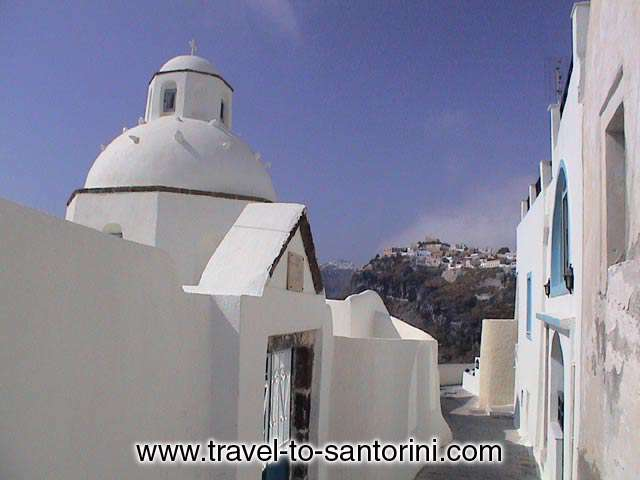 AGIOS MINAS - The church of Agios Minas in the narrow pathways at the edge of the Caldera. <br>One of the most photographed churches in Santorini
